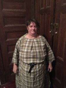 Wearing the tunic, belted, over a chemise.