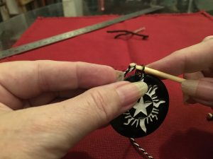 Threading the medallion, step 1.