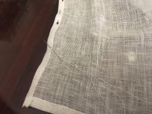 Needle angled to capture warp & weft threads.