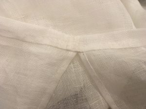Casing at top of armhole.