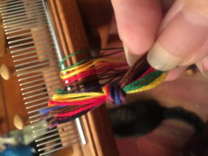 Overhand knot tying loops (bowes) together.